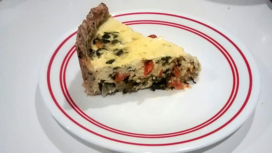 This Spinach and Sun-Dried Tomato Quiche with Toasted Sesame Crust has a dichotomy of crispy crust and creamy spinach, sun-dried tomato custard.