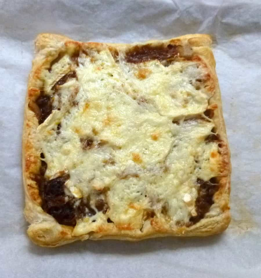 Flaky puff pastry filled with sweet caramelized onions and melty brie.
