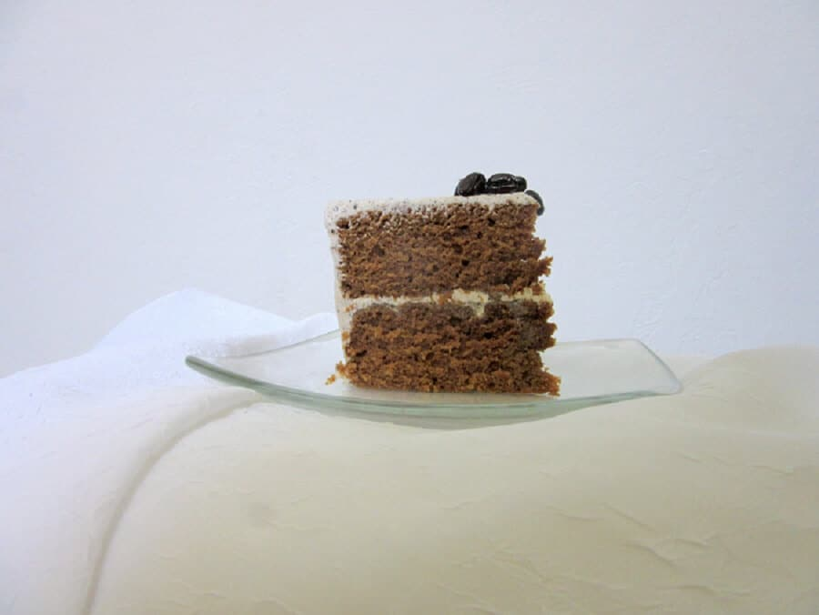 A few roasted coffee beans on top of this Thai tea Vietnamese coffee cake add an awesome crunch and another pop of coffee flavor. #thaitea #vietnamesecoffee #cake #dessert