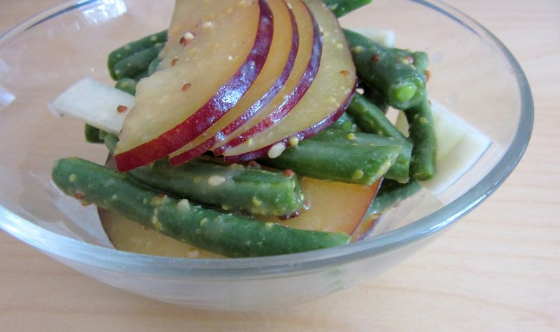 This plum and green bean salad with miso dressing only gets better with time, since the juicy plums and crunchy green beans get to soak up the dressing. || Delicious Not Gorgeous
