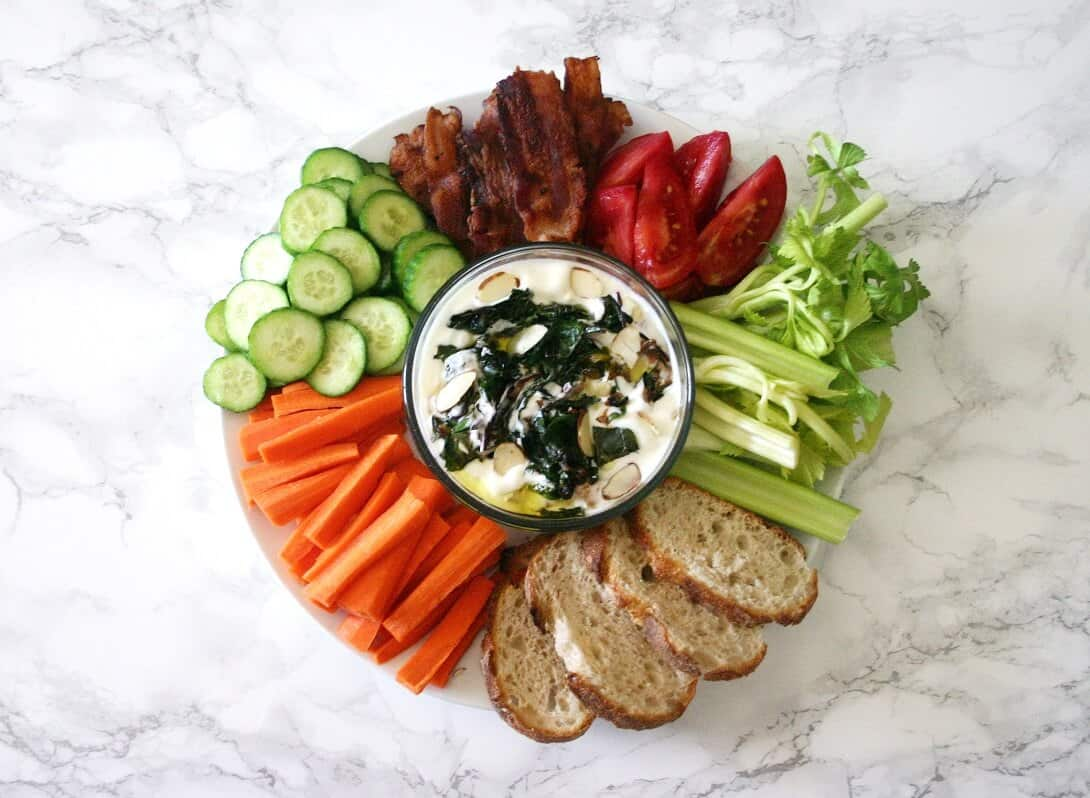 This garlicky yogurt dip with herb jam and toasted almonds is creamy and satisfying, without being weighed down with sour cream or mayonnaise. #greekyogurt #crudites #appetizer