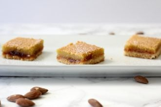 If you're into the flavor of marzipan, then you'll like these layered almond shortbread bars. #raspberry #almond #shortbread #barcookies