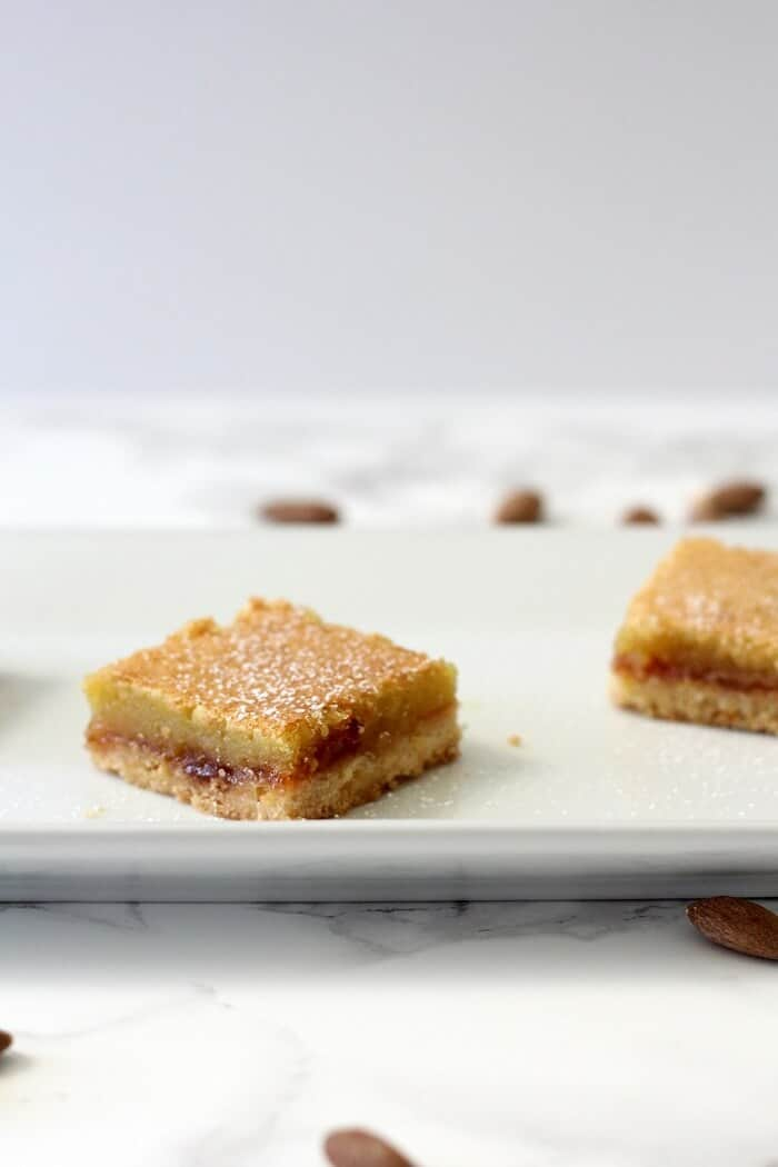 Creamy almond filling, tangy raspberry jam and crumbly shortbread make for some really delicious layered almond shortbread bars. #raspberry #almond #shortbread #barcookies