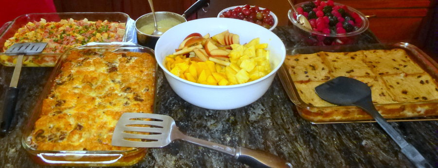 french toast casserole, sausage/potato breakfast casserole, eggs benedict casserole, fruit