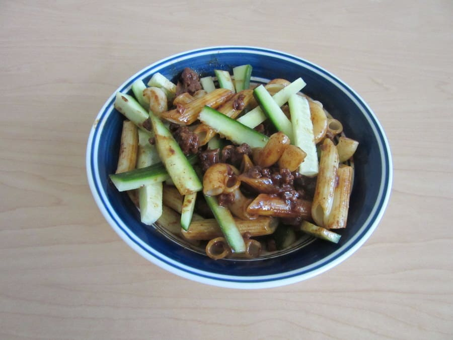 This version of zha jiang mian features pasta topped with a flavorful Chinese black bean sauce, ground beef and crunchy cucumber.