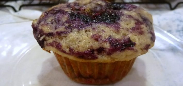 America's Test Kitchen's Best Blueberry Muffins feature whole berries stirred in, as well as blueberry compote and lemon sugar swirled into the tops. #americastestkitchen #lemon #blueberry #blueberrymuffins