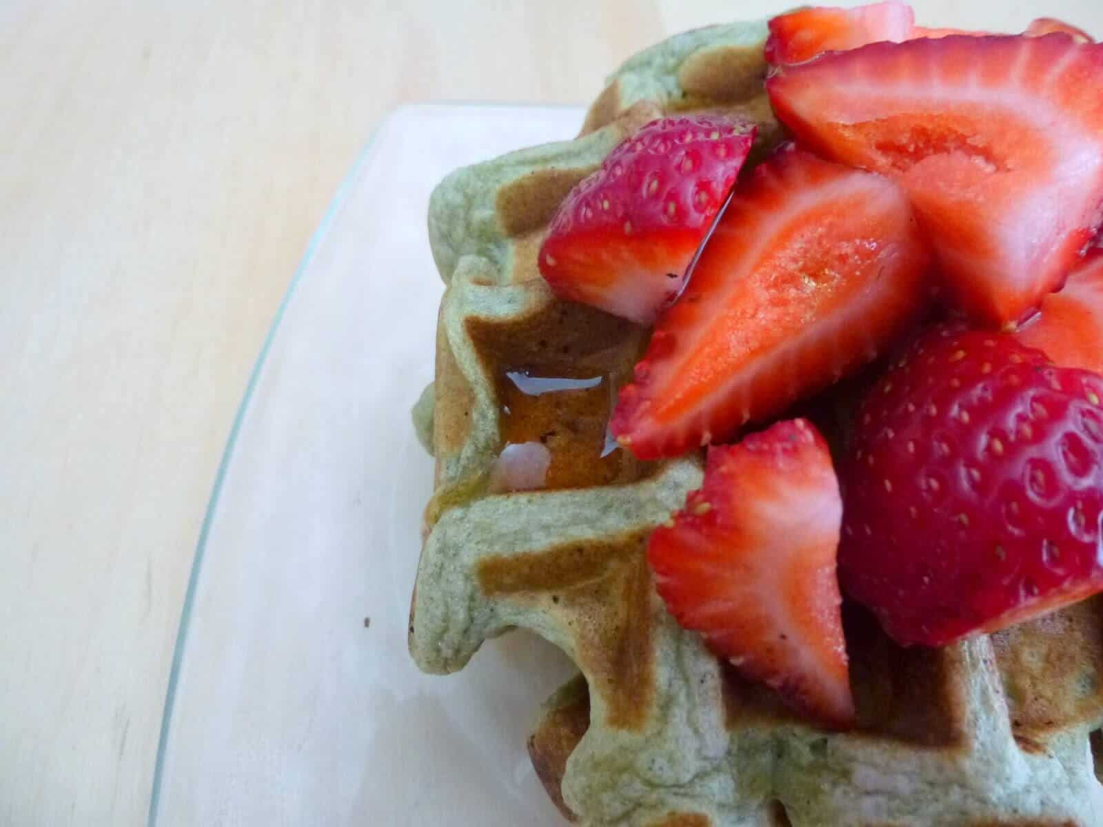 Top these matcha waffles with plenty of strawberries and maple syrup. #matcha #waffles #breakfast #brunch