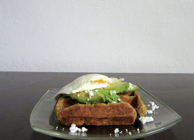 This pumpkin spice waffle is topped with avocado, a fried egg and feta. #pumpkinspice #waffles #avocado #eggs