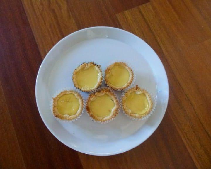 These Hong Kong style dan tats, or egg custard tarts, pair silky smooth, eggy custard with flaky, crispy pastry. #dantat #chinese #dessert #custard