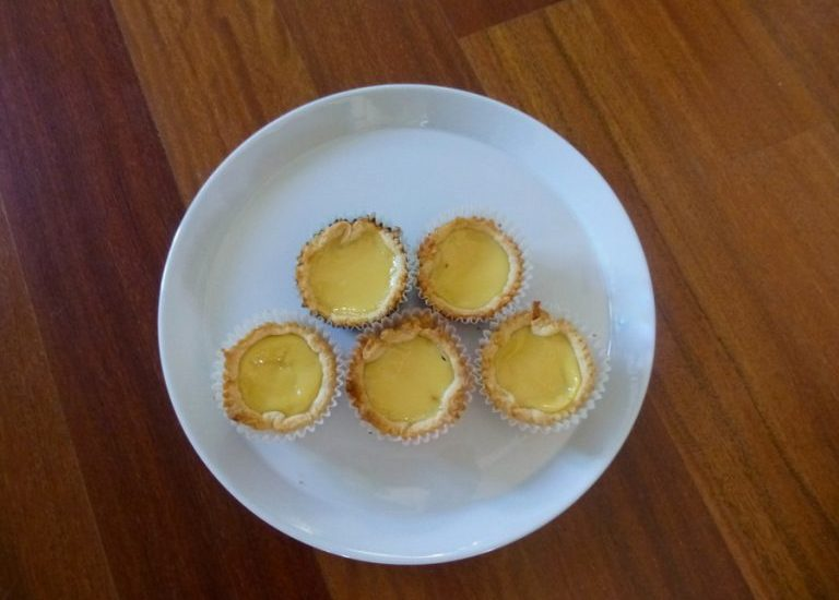 These Hong Kong style dan tats, or egg custard tarts, pair silky smooth, eggy custard with flaky, crispy pastry. #dantat #chinese #dessert #custard