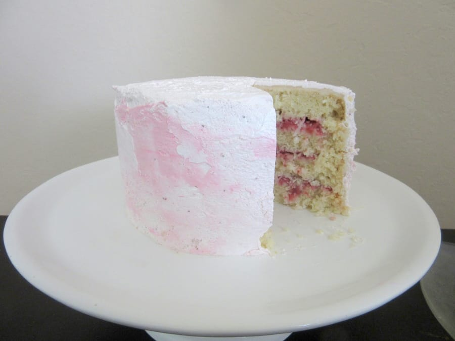 Coconut and strawberry isn't the most common combo, but this coconut cake with strawberry compote and pink Swiss meringue buttercream is delicious anyways.