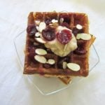 These cherry jasmine waffles have fluffy on the inside, crispy on the outside waffles, topped with cherry sauce and jasmine whipped cream. #cherries #jasminetea #waffles #brunch #whippedcream