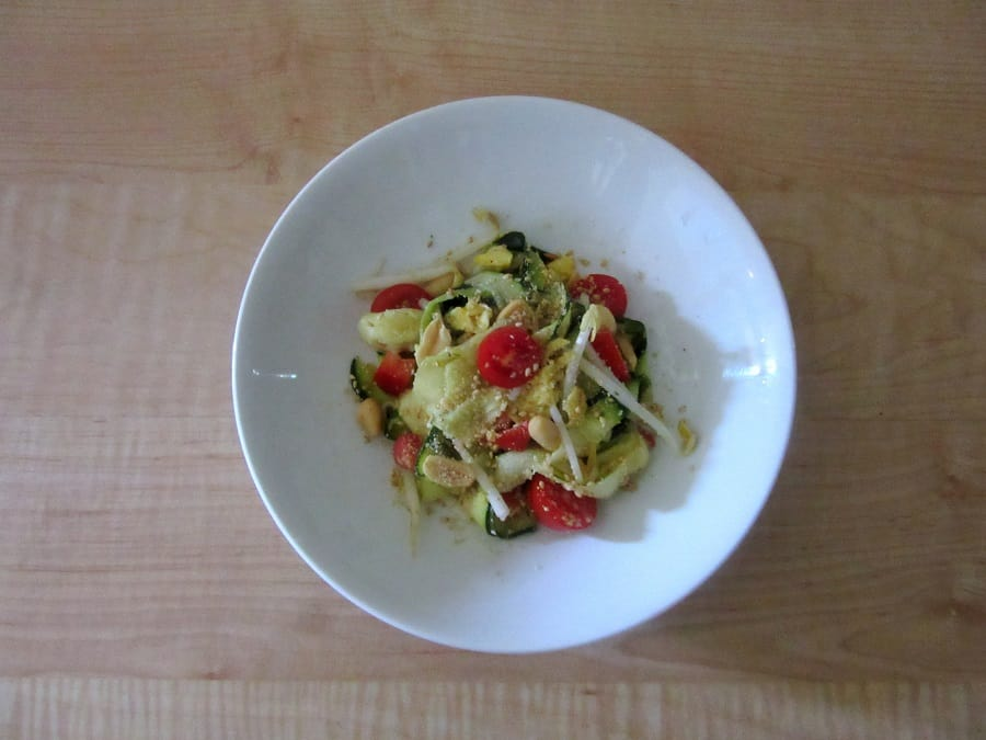 This vaguely Thai zoodle salad features crunchy veggies tossed with zoodles and a creamy, tangy peanut dressing before getting topped with more peanuts.