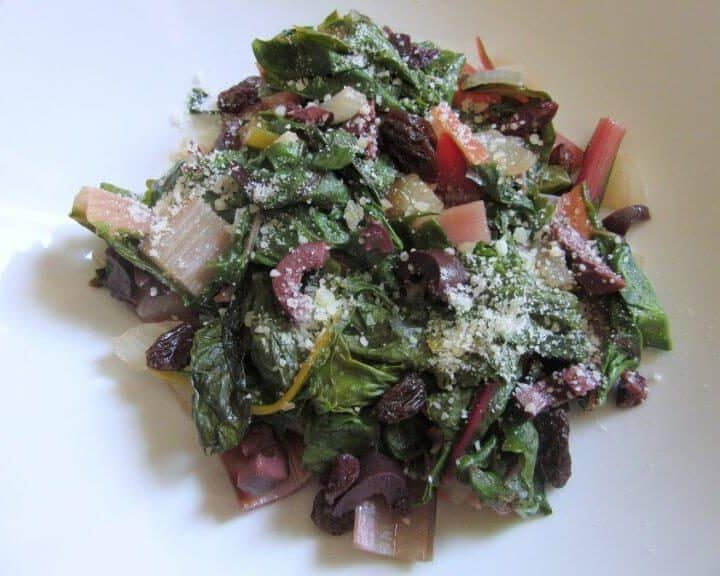 This garlicky Swiss chard with olives, parmesan and raisins is a good way to get out of your plain sauteed chard with salt rut. #swisschard #olives #parmesan #raisins #vegetarian