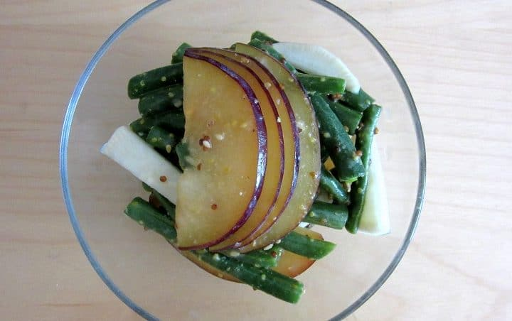 This plum and green bean salad with miso dressing only gets better with time, since the juicy plums and crunchy green beans get to soak up the dressing. || deliciousnotgorgeous.com