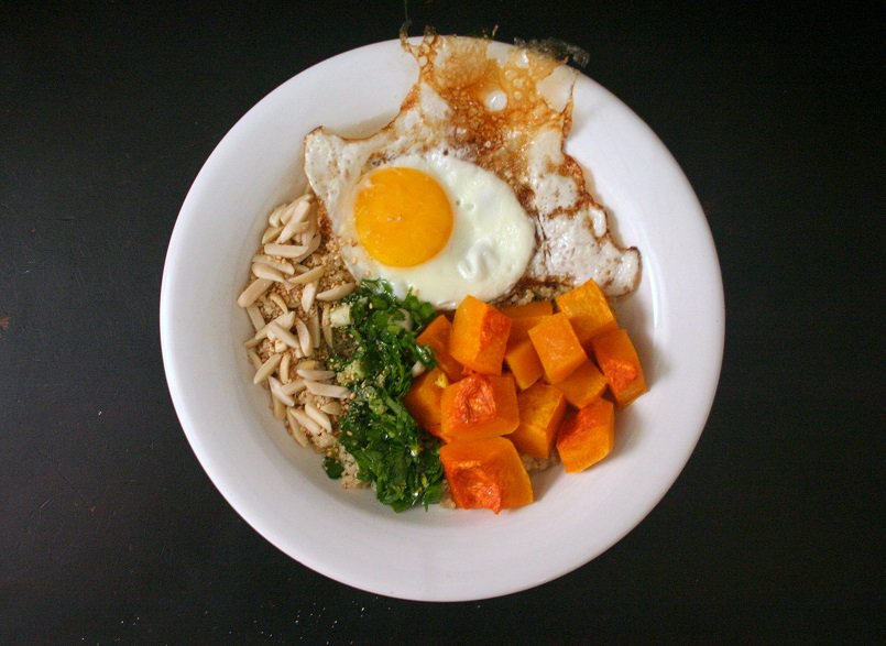 These chimichurri and butternut squash quinoa bowls are hearty and filling, especially with a fried egg and some toasted almonds on top.