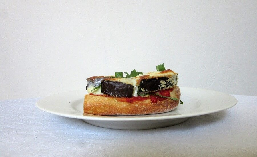 Eggplant parm melts: a handheld dinner. No need to fry the eggplant (or even bread it), and it bakes up faster than the traditional eggplant parm. #eggplantparmesan #italianfood #openfacedsandwich