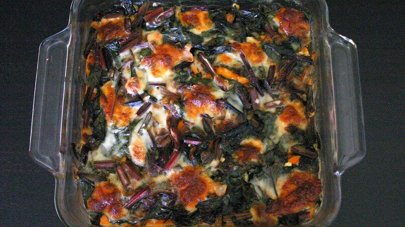 This Swiss chard and sweet potato gratin has tons of veggies, but still has that tender, cheesy vibe that screams comfort food. #swisschard #sweetpotato #vegetarian #entree