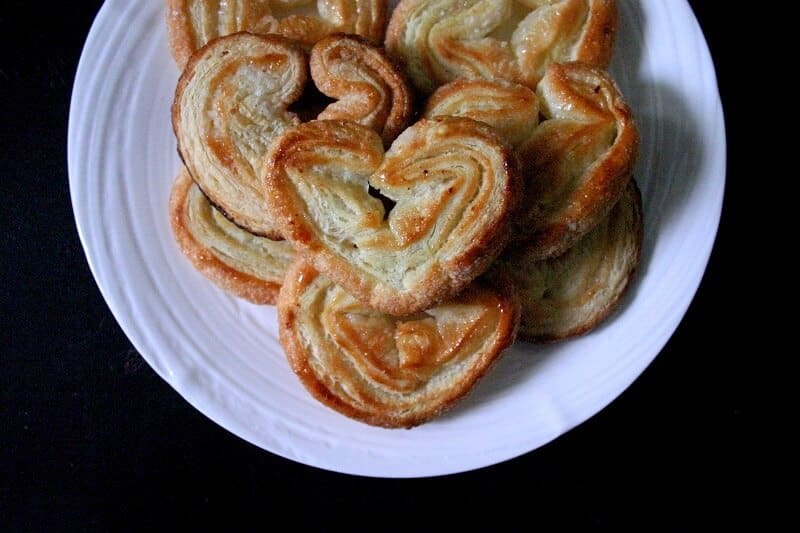Palmiers, the crispy, sugary French cookies, are so easy and so tasty. It takes two ingredients, and 20 minutes to make this impressive treat. #french #palmiers #cookies #puffpastry