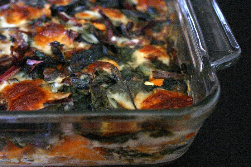All the leafy greens in this Swiss chard and sweet potato gratin get mellowed out by bubbly, browned cheese. #swisschard #sweetpotato #vegetarian #entree