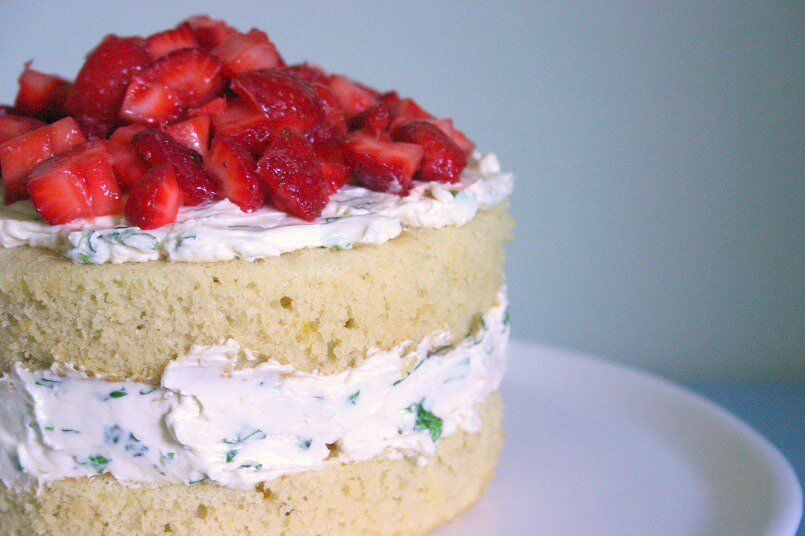 This strawberry lemonade cake with fresh mint buttercream isn't frosted on the outside, letting you see the fluffy lemon cake inside. #strawberry #lemon #mint #cake