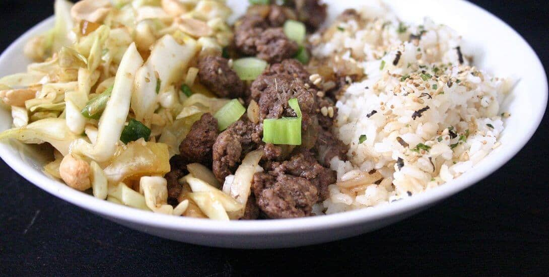 These beef rice bowls with sesame cabbage slaw are even better when garnished with roasted peanuts, green onions and furikake. #beef #ricebowl #cabbageslaw #dinnerideas