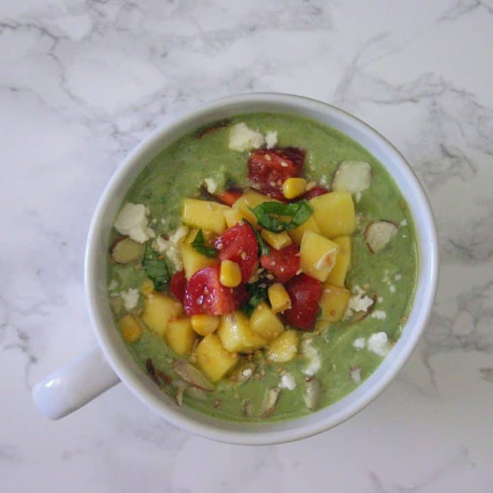 This avocado cucumber soup is good plain, but the mango salsa is what really makes this dish.