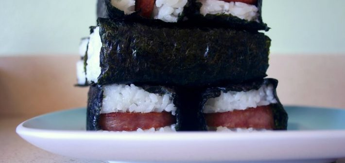 You may have queasy memories revolving the squishy meat product known as spam. But pan-fried, coated in teriyaki, and tucked into a rice and seaweed hug, it transforms into lunchtime hero spam musubi. #spammusubi #japanese #hawaiian #spam #rice #seaweed