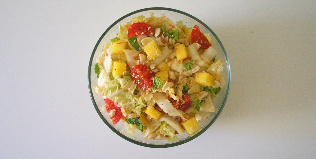 This nutty mango and napa cabbage slaw is fresh and full of texdture, making it perfect for the perfect summer or early fall side dish.
