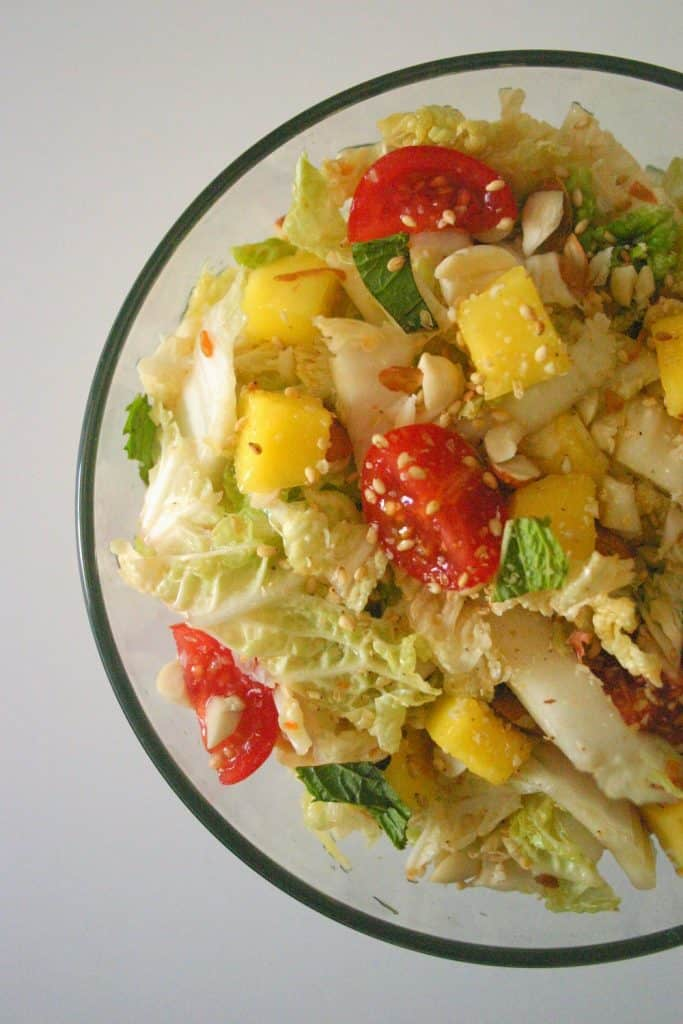 This nutty mango and napa cabbage slaw gets plenty of color from fresh mint, cherry tomatoes and mango.