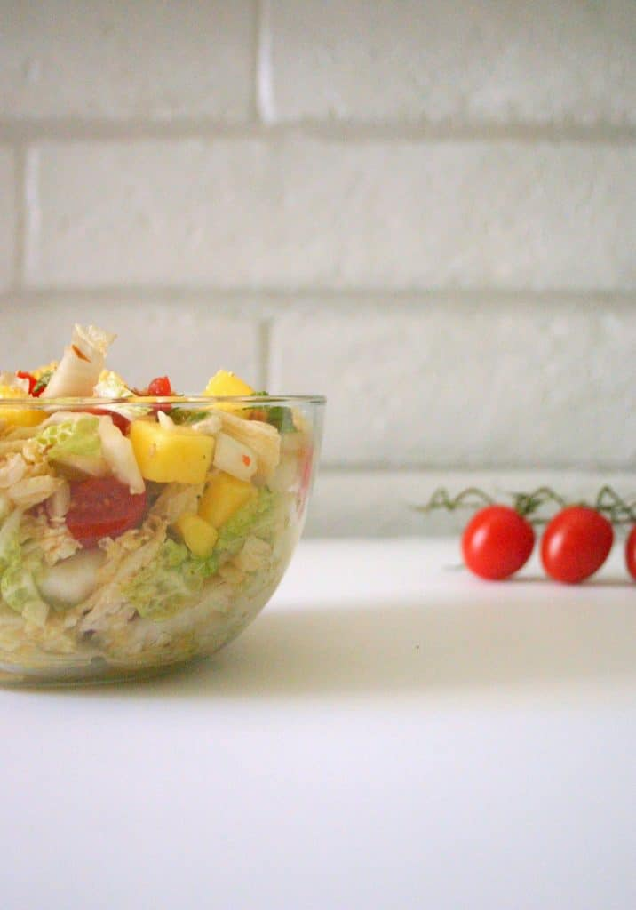 This nutty mango and napa cabbage slaw balances crunchy napa cabbage with juicy cherry tomatoes and mangoes.