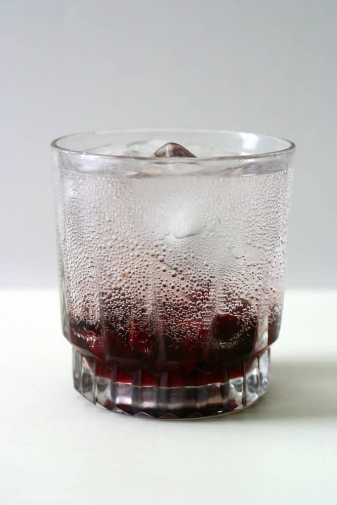 This sparkling lemon cherry soda is crystal clear on top with a heaping of dark cherries at the bottom before you stir it.