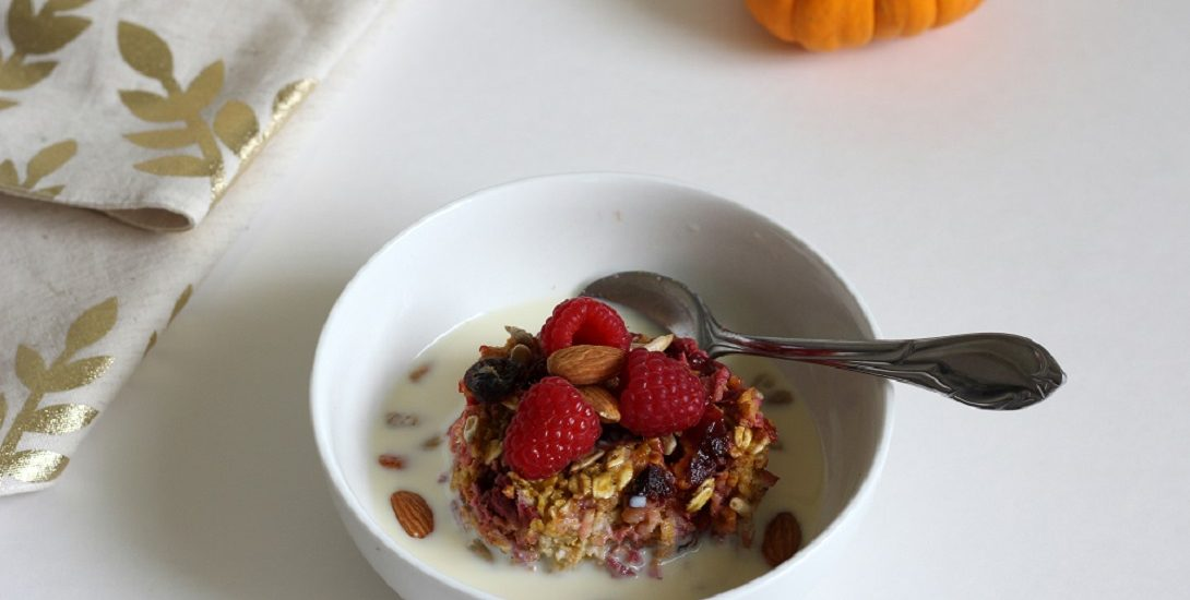 This pumpkin cranberry raspberry oatmeal is perfect for a fall breakfast, decorative pumpkins not required. #bakedoatmeal #pumpkin #cranberry #raspberry #breakfast