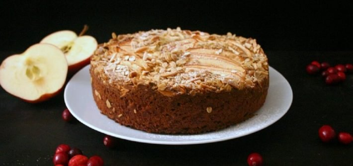 This apple cake with almond crumb topping is the perfect fall dessert when all you want are apples and cranberries. #cranberry #fallbaking #cakes #almond