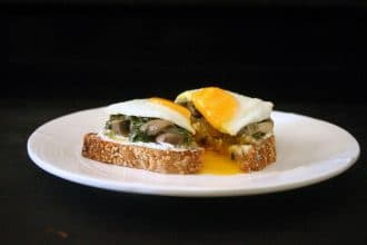 This herbed feta and mushroom confit crostini is perfect topped with a super runny egg yolk. #basil #feta #toast #mushroom