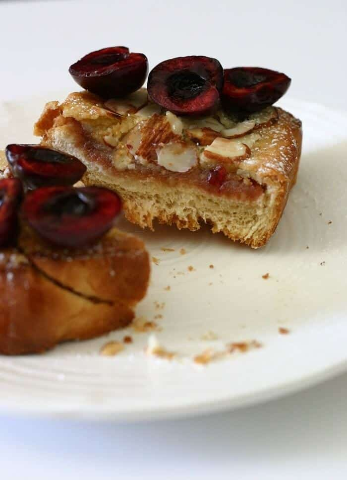 This cross-section of the almond cherry bostock shows off generous layers of cherry jam and almond frangipane on top of decadent brioche. #cherry #almond #french #bostock #brunch