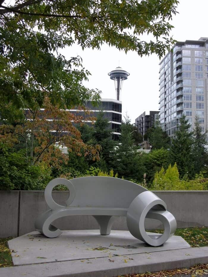 A twisty silver bench in the Olympic Sculpture Park in Seattle, WA. Travel Guide to Seattle: Delicious Not Gorgeous Edition #seattle #washington #travel