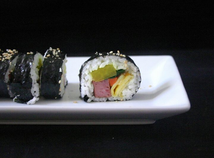 The inside of this spam kimbap looks like a kaleidoscope, with pickled radish, spinach, carrots, eggs and Spam. #spam #kimbap #korean #sushi
