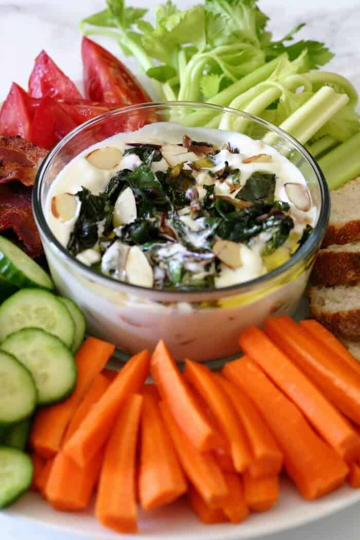 Serve this garlicky yogurt dip with whatever you'd like. Here, I've used carrots, cucumbers, celery, tomatoes, crostini and bacon (why not?!). #greekyogurt #crudites #appetizer