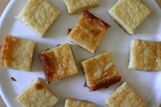 Butter mochi is a classic Hawaiian treat that features sweet rice flour, which gives the dessert its characteristic chewy texture. #buttermochi #custardmochi #mochi #hawaiian #dessert