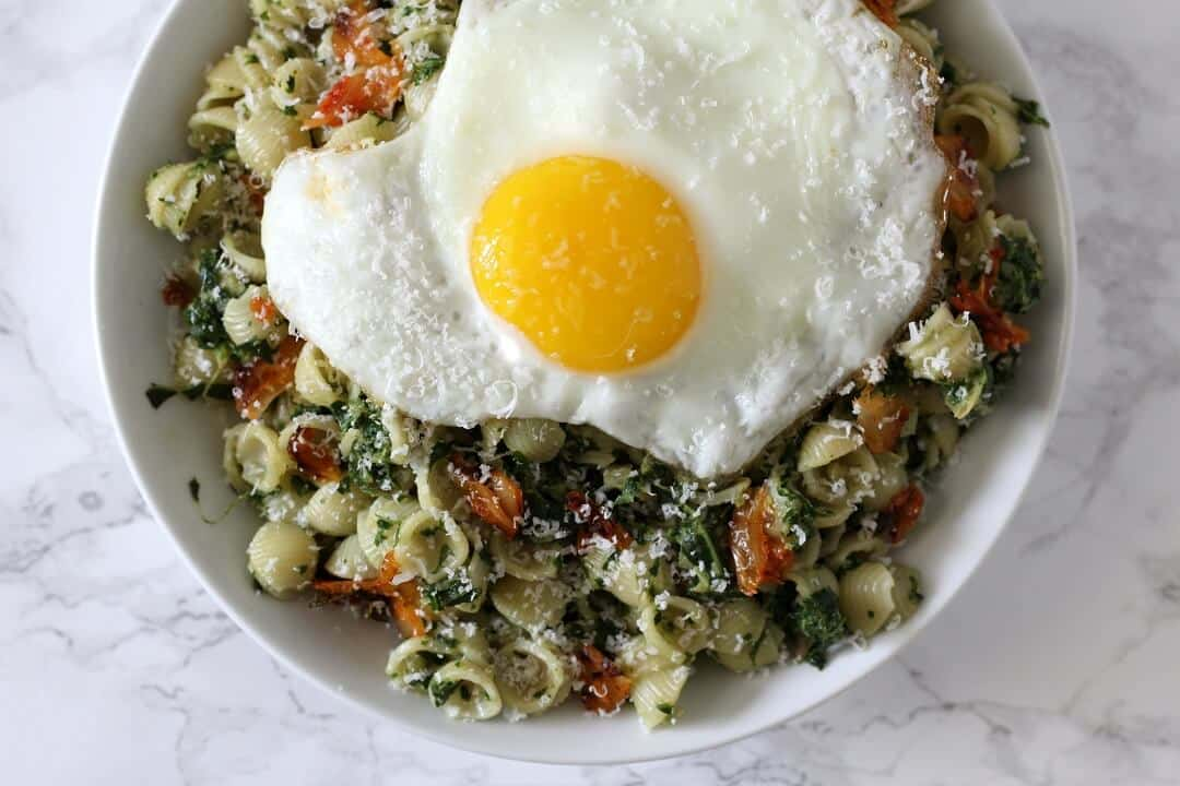 This creamed kale and kimchi pasta features a creamy kale and coconut milk sauce with plenty of crunchy, funky kimchi. #kale #kimchi #pasta #entree