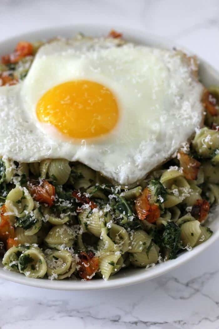 Top this creamed kale and kimchi pasta with as many sunny-side up eggs as you want! #kale #kimchi #pasta #entree