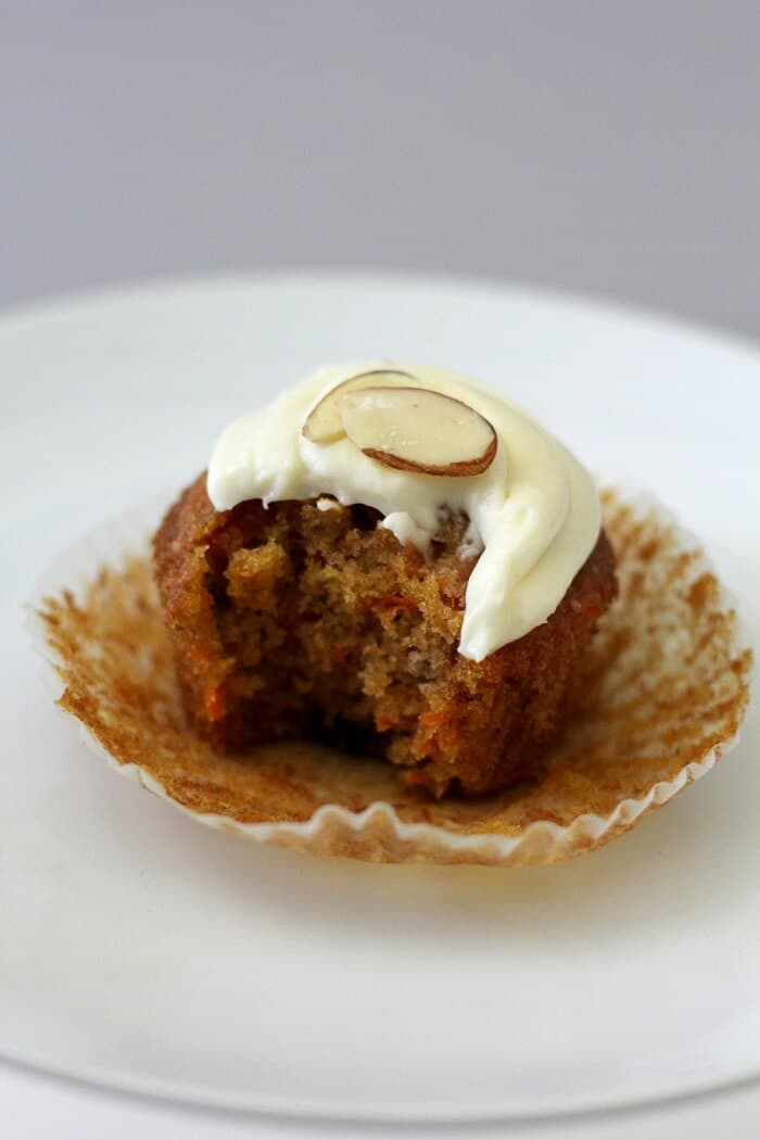 These masala chai carrot cupcakes are studded with plenty of carrots and raisins. #carrotcake #cupcakes #creamcheesefrosting #chai