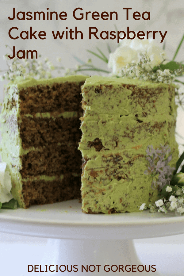 Have your tea, and eat it, too. This jasmine green tea cake with raspberry jam has jasmine tea infused cake, with matcha flavored buttercream. #jasminetea #matcha #cake #raspberryjam