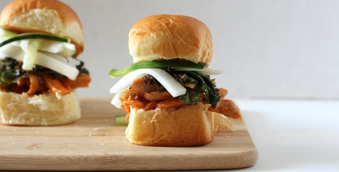 These kimchi chicken sliders combine fluffy Hawaiian rolls, juicy chicken, tender kimchi and kale, and crunchy quick pickles. #kimchi #chicken #sliders #hawaiianrolls