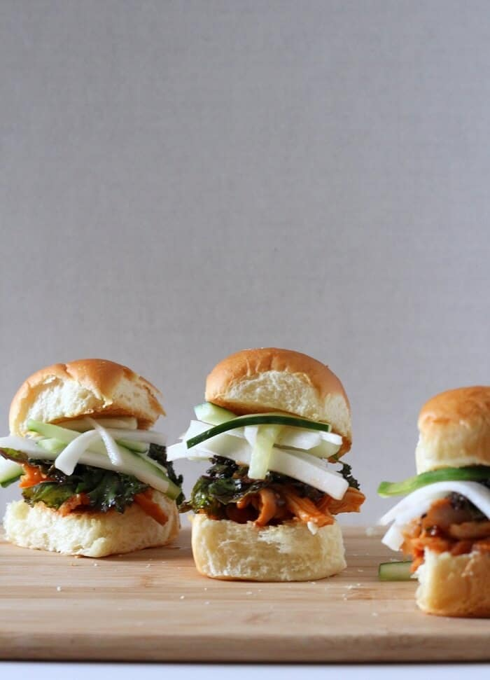 These kimchi chicken sliders on Hawaiian rolls are even better when you add sweet/tart quick pickles on top. #kimchi #chicken #sliders #hawaiianrolls