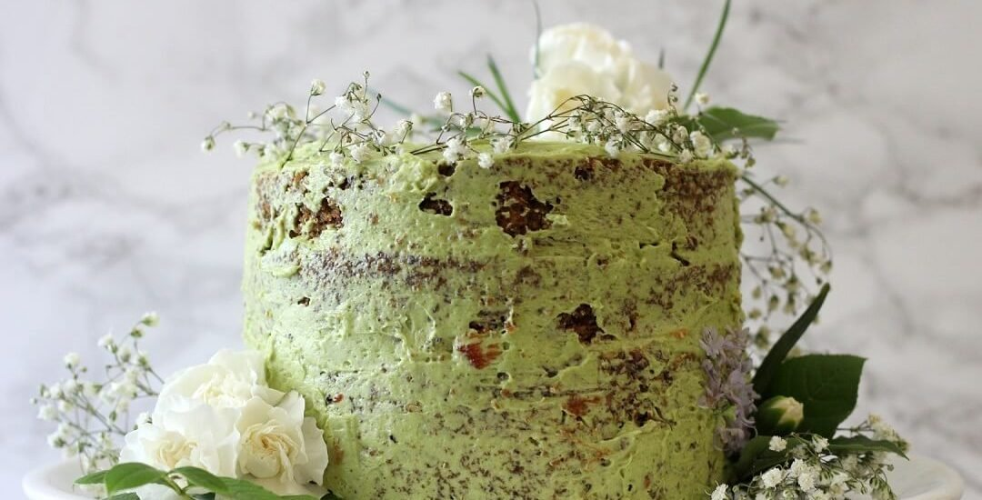 This jasmine green tea cake with raspberry jam pairs floral jasmine-scented cake with plenty of bright (in flavor and color!) matcha buttercream. #jasminetea #matcha #cake #raspberryjam