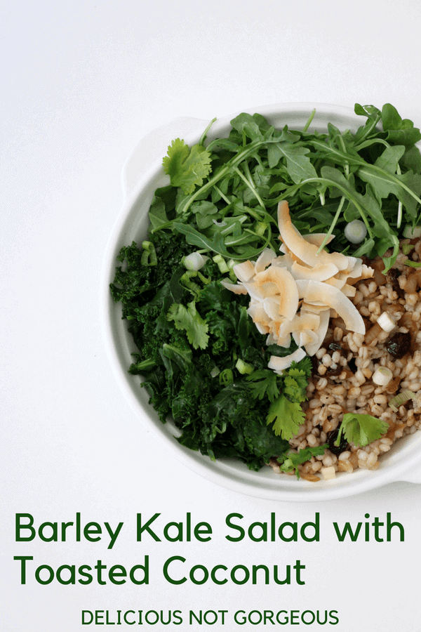 This barley kale salad with toasted coconut is the grains + greens salad you never knew you needed. Paired with sweet/tart dried cherries and punchy sesame soy vinaigrette, it's a delicious make-ahead lunch. #barley #kalesalad #coconut #salad