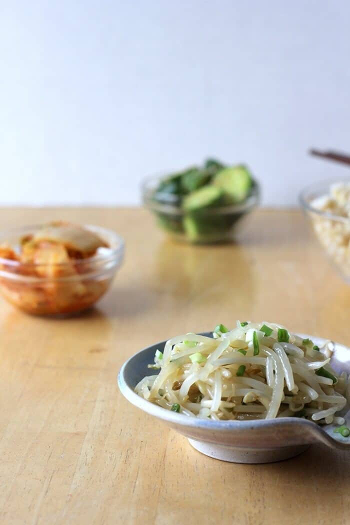 Sakamoto namul, or marinated bean sprouts, is perfect for serving with other Korean side dishes (banchan), like marinated cucumbers and kimchi. #beansprouts #koreanfood #banchan #vegetables