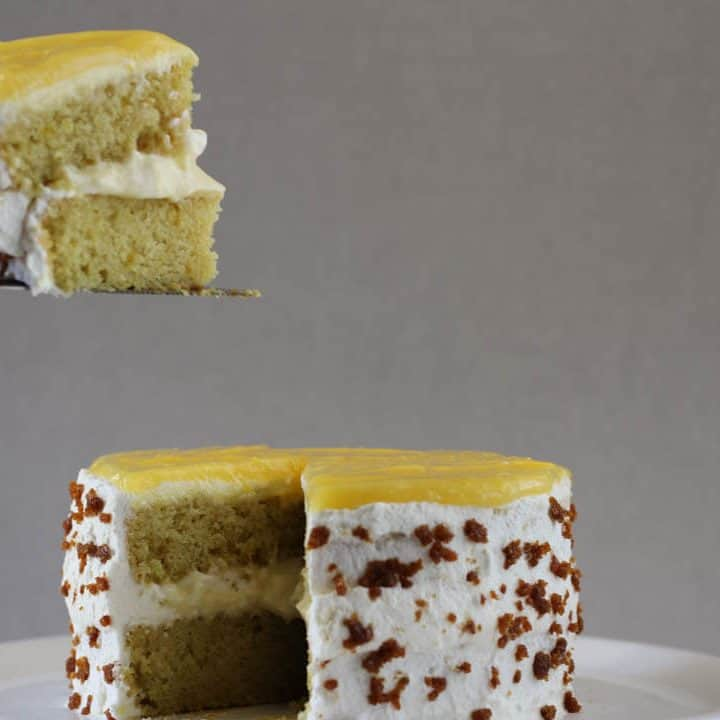 This lemon crunch cake is studded with bits of toffee, adding a caramelly flavor and a nice crunch to the cake. #lemoncake #layercake #toffee #pastrycream #whippedcream